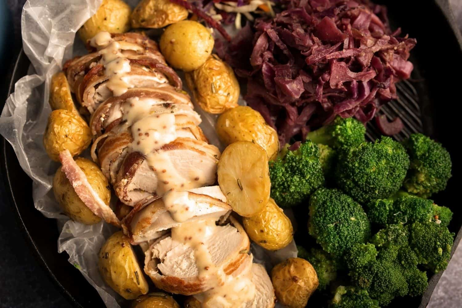 Bacon Wrapped Pork Fillet OR Chicken with Braised Red Cabbage, Roast Potato & Broccoli