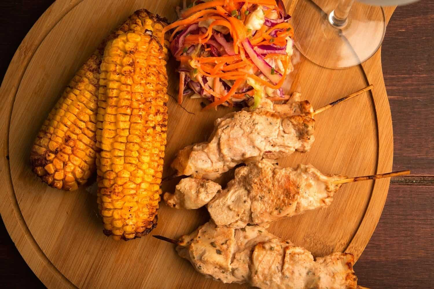 Chicken kebabs with grilled corn and crunchy slaw