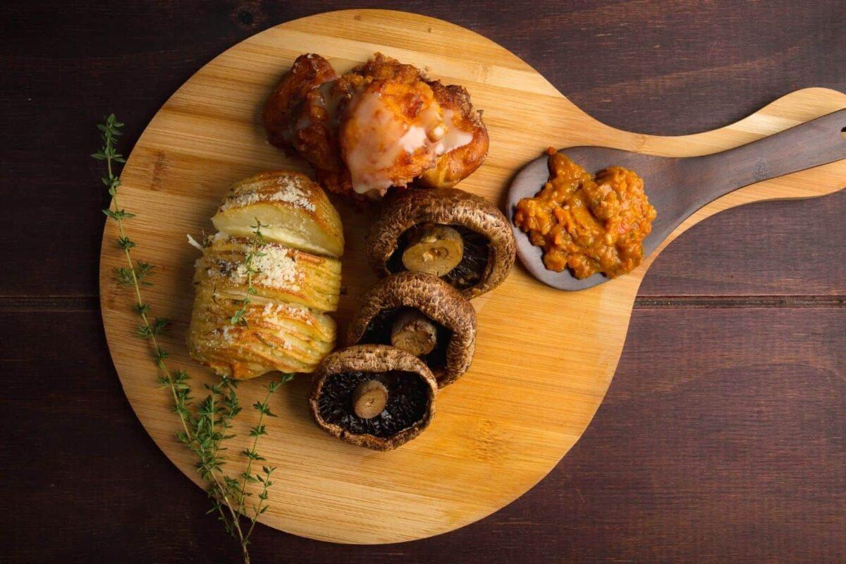 Grilled Portabello Mushroom, Hasselback Potato, Pumpkin Fritters & Chakalaka