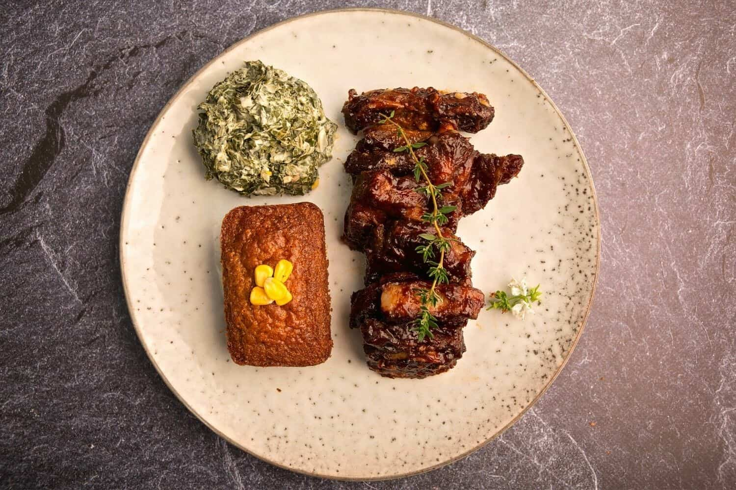 Slow braised beef short rib, homemade BBQ sauce, corn bread and creamed spinach